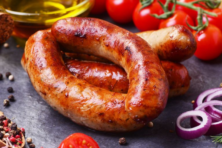 102467396 – pork sausages with spices and vegetables